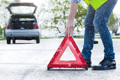 Man placing a reflective red triangle Stock Photography