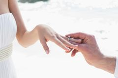 Man placing ring on brides finger Stock Images