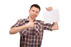 Man in a plaid shirt with blank white board Royalty Free Stock Photo