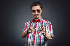 Man in plaid shirt and bow tie with glasses Royalty Free Stock Images