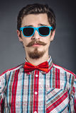 Man in plaid shirt and bow tie with glasses Royalty Free Stock Photography