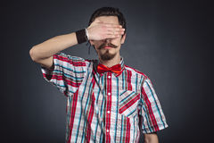 Man in plaid shirt and bow tie Royalty Free Stock Photos