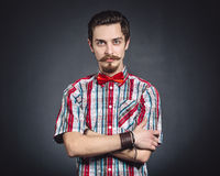 Man in plaid shirt and bow tie Stock Photo