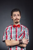 Man in plaid shirt and bow tie Stock Photography