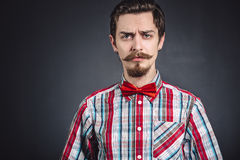 Man in plaid shirt and bow tie Stock Images