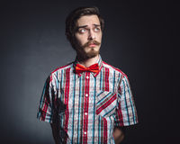 Man in plaid shirt and bow tie Stock Photos