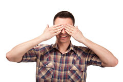 Man in plaid shirt covering his eyes Stock Images