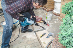 Man working in yard puncher Royalty Free Stock Photo