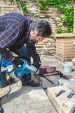 Man working in yard puncher Stock Image