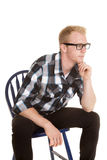 Man in plaid shirt glasses look side hand chin Stock Photos