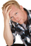 Man in plaid shirt hand in hair look Royalty Free Stock Image