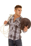 Man plaid shirt rope western hat hold look side. A man looking to the side holding on to her rope and hat royalty free stock images