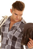 Man plaid shirt rope western hat look down close Royalty Free Stock Photography