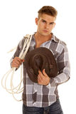Man plaid shirt rope western hat looking Royalty Free Stock Image