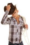Man plaid shirt rope western hat put on Stock Image