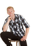 Man in plaid shirt sit looking smiling Royalty Free Stock Photos