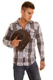 Man plaid shirt western hat in hand look down. A cowboy looking down holding onto his hat stock photos