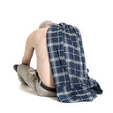 Man with a plaid turned back and looking down Royalty Free Stock Image