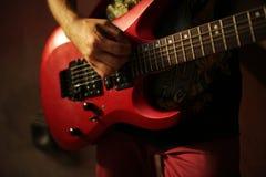 Man plaing guitar  on sunset Royalty Free Stock Image