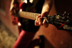 Man plaing guitar  on sunset Royalty Free Stock Photography