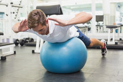 Man in plank position on exercise ball Stock Photos