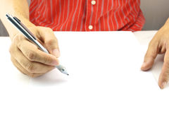 Man planning business on white paper. Man is planning to do business and present on white paper Royalty Free Stock Image