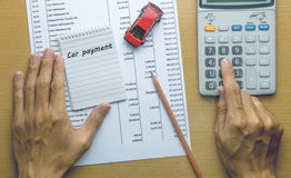 Man Planning Car payment Royalty Free Stock Photography