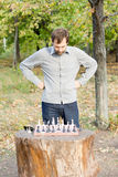 Man planning his chess strategy Stock Images