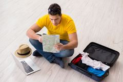 The man planning his vacation trip with map. Man planning his vacation trip with map royalty free stock image