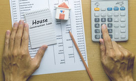 Man Planning monthly House construction loan. Finance concept royalty free stock image