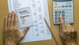 Man Planning monthly income and account expenses Stock Photography