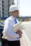 Man with plans on construction site Stock Photography