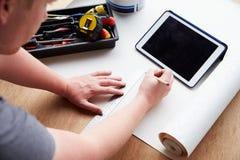 Man Plans Design Project Using Application On Digital Tablet Stock Images
