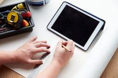 Man Plans Design Project Using Application On Digital Tablet Stock Image