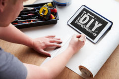 Man Plans Design Project Using Application On Digital Tablet Royalty Free Stock Images