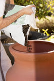 Man Planting In A Garden Stock Photography