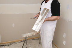 Man plastering Stock Images