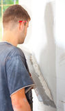 Man plastering the wall Stock Photo