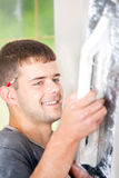 Man plastering the wall Stock Images