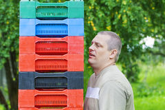 Man with plastic boxes in the garden Stock Photos