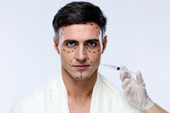 Man at plastic surgery with syringe Stock Photography