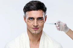 Man at plastic surgery with syringe Royalty Free Stock Photos