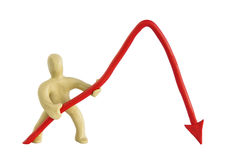 A man from plasticine holds a negative graph. A man from plasticine holds a red arrow negative chart Royalty Free Stock Photography
