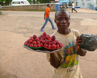 Man with a plate with plums. Royalty Free Stock Images