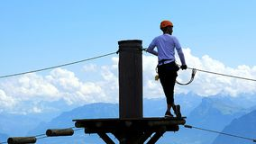 Man on platform in the Pilatus rope park royalty free stock photography