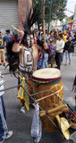 Man play a big drum with a prehispanic costume Royalty Free Stock Images