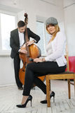 While man play contrabass woman Royalty Free Stock Photos