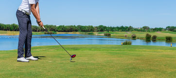 Man Play Golf. With The Stick On The Green Field. Stock Image