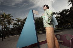 Man on a play ground sailboat Royalty Free Stock Photography