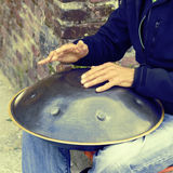 Man play instrument made of metal and called hang Royalty Free Stock Images